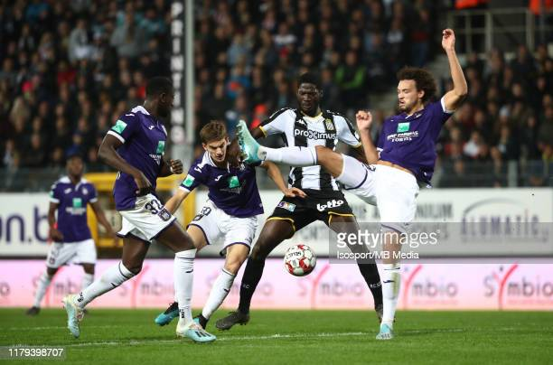 Sieben Dewaele of Anderlecht battles for the ball with Shamar Nicholson of Charleroi and Philippe Sandler of Anderlecht during the Jupiler Pro League...
