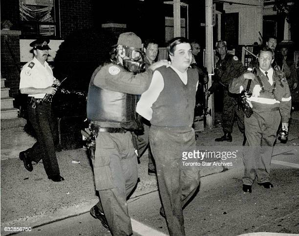 Siege ends Members of Metros emergency task force surround a man as he leaves a Dufferin St house yesterday after a 6 hour siege Police filled the...