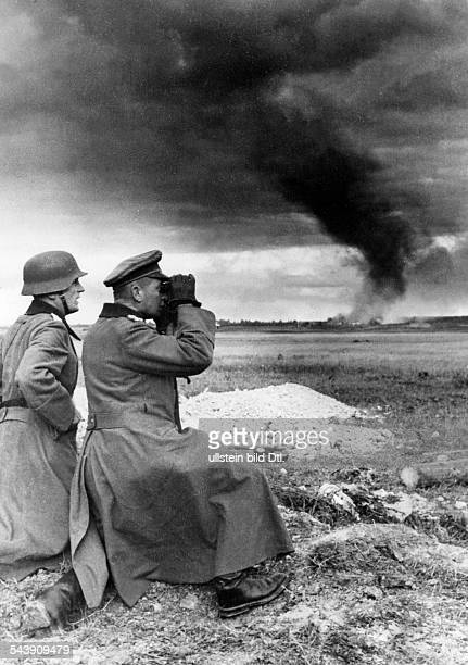 Siege on Leningrad two German Wehrmacht soldiers one of them major general Krueger are watching German attacks on the russian defense line 1941...