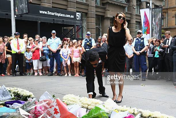 Siege victims Joel Herat and Elly Chen pay their respects at wreath laying ceremony after the funeral for Tori Johnson at Martin Place on December 23...