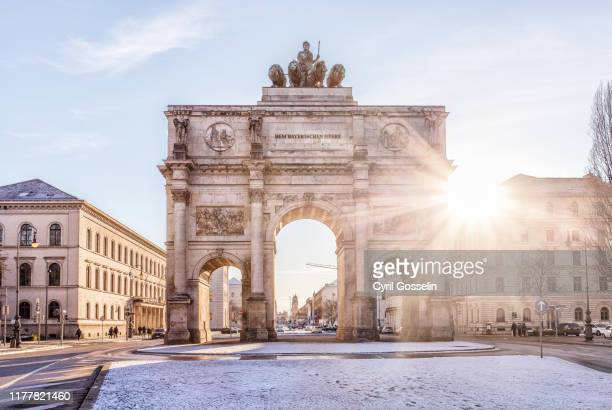 siegestor against clear sky - munich stock pictures, royalty-free photos & images