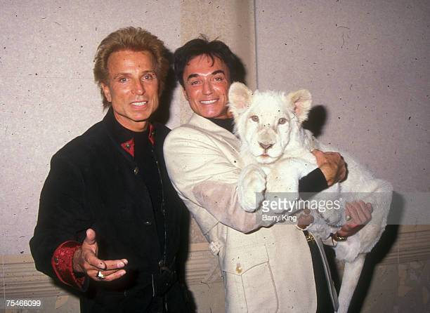 Siegfried and Roy with White Lion cub