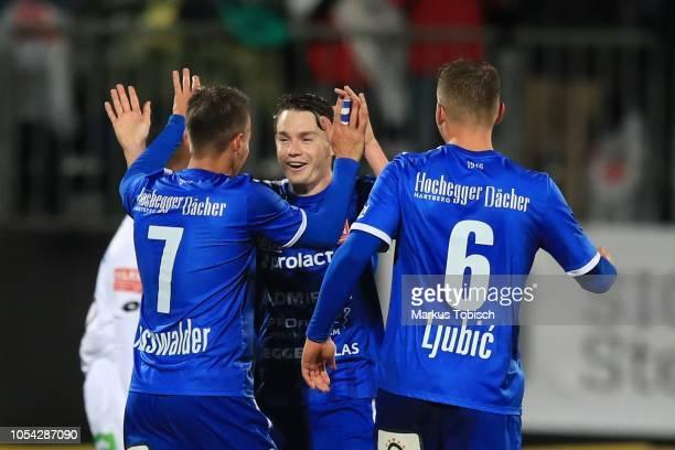 Siegfried Rasswalder, Florian Flecker and Ivan Ljubic of Hartberg celebrate during the tipico Bundesliga match between TSV Hartberg and Sturm Graz at...