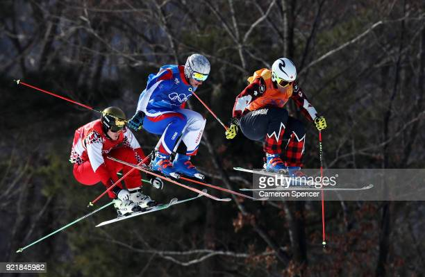 Siegmar Klotz of Italy Sergey Ridzik of Olympic athletes of Russia and Francois Place of France compete in the Freestyle Skiing Men's Ski Cross 1/8...