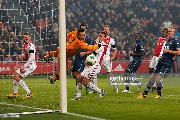 Siem De Jong of Ajax gets a touch on the ball to put the ball past goalkeeper Erwin Mulder of Feyenoord during the Eredivisie match between Ajax...