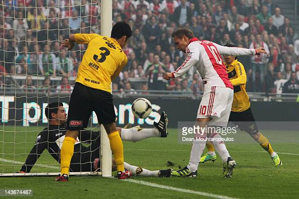 Siem de Jong of Ajax scores the first goal of the game as defender Maya Yoshida of Venlo can on watch during the Eredivisie match between Ajax...