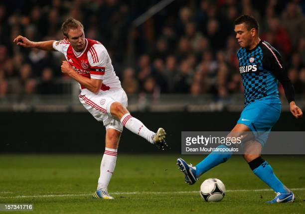 Siem De Jong of Ajax shoots on goal as Wilfred Bouma of PSV attempts the block during the Eredivisie match between Ajax Amsterdam and PSV Eindhoven...