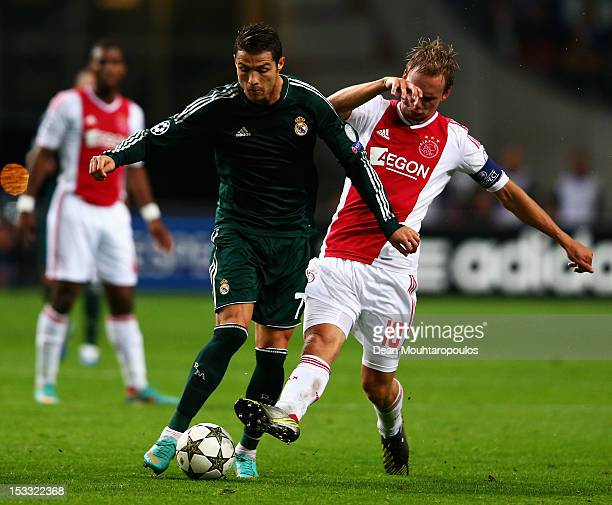 Siem De Jong of Ajax tackles Cristiano Ronaldo of Real during the UEFA Champions League Group D match between Ajax Amsterdam and Real Madrid at...