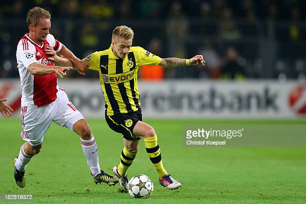 Siem De Jong of Amsterdam challenges Marco Reus of Dortmund during the UEFA Champions League group D match between Borussia Dortmund and Ajax...