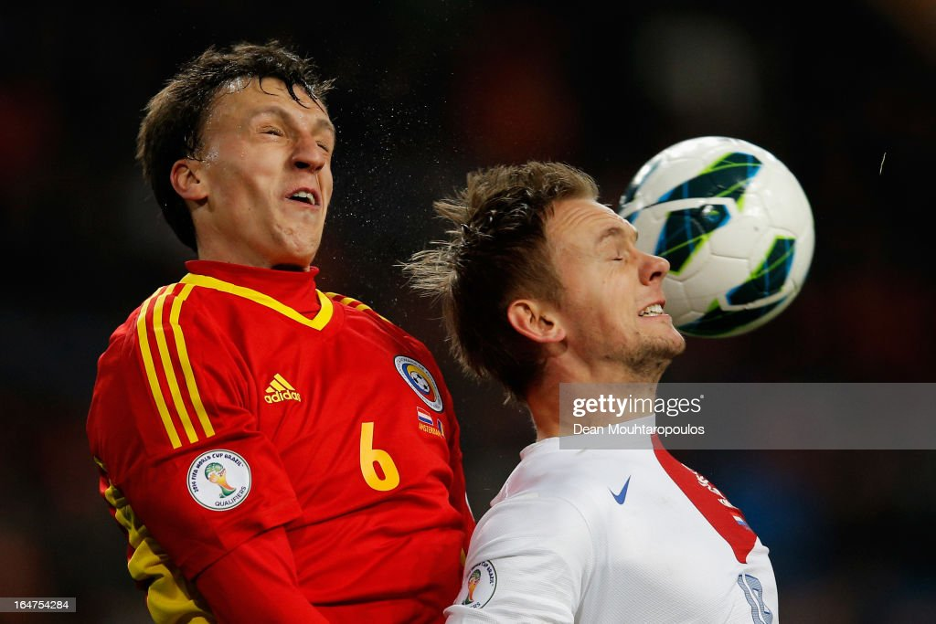 Siem De Jong of Netherlands and Vlad Chiriches of Romania battle for the header during the Group 4 FIFA 2014 World Cup Qualifier match between Netherlands and Romania at Amsterdam Arena on March 26, 2013 in Amsterdam, Netherlands.