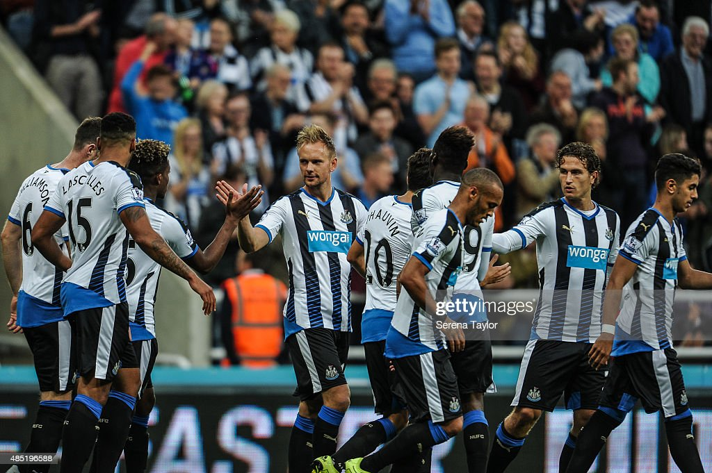 Siem de Jong (fourth from left) of Newcastle celebrates with teammates after scoring the second goal during The Capital One Cup second round match between Newcastle United and Northampton Town at St.James Park on August 25, 2015, in Newcastle upon Tyne, England.