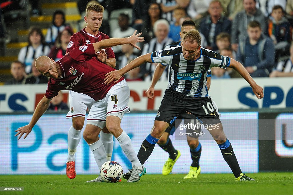 Siem de Jong (R) of Newcastle is challenged by Jason Taylor (L) of Northampton during The Capital One Cup second round match between Newcastle United and Northampton Town at St.James Park on August 25, 2015, in Newcastle upon Tyne, England.