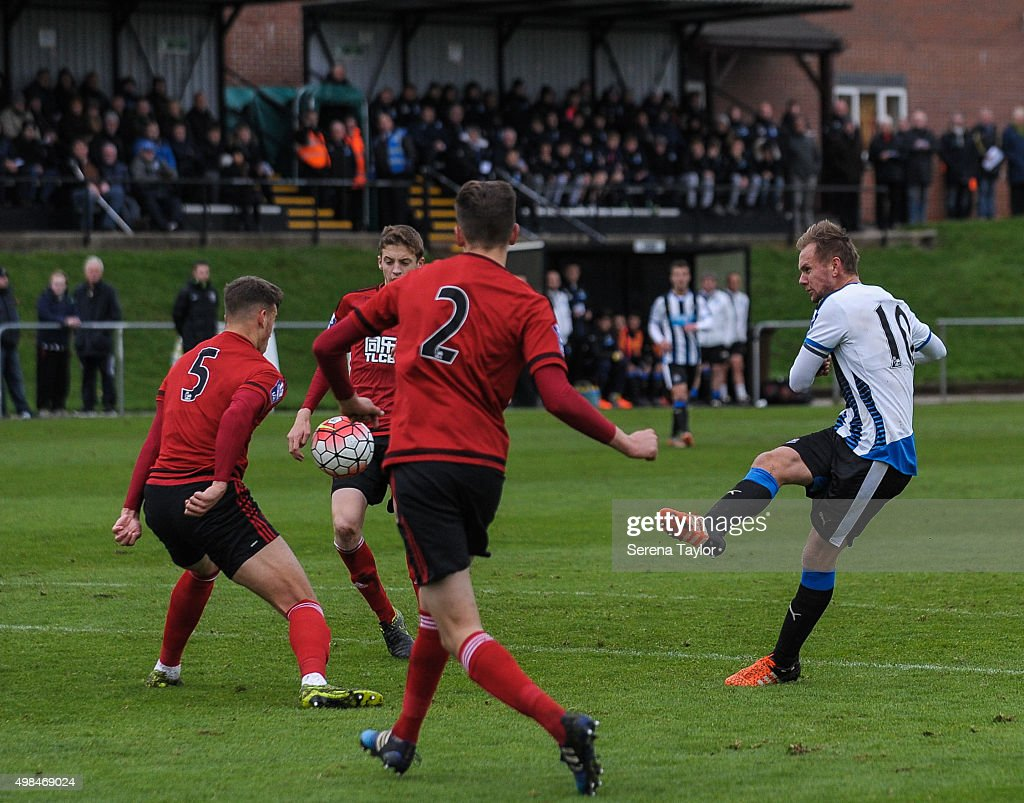 Siem de Jong (R) of Newcastle strikes the ball during the U21 Premier League Match between Newcastle United and West Bromwich Albion at Whitley Park on November 23, 2015, in Newcastle upon Tyne, England.