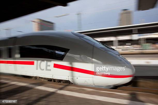 A Siemens AG 407 series InterCity Express 3 VelaroD train operated by Deutsche Bahn AG leaves the central railway station in Frankfurt Germany on...