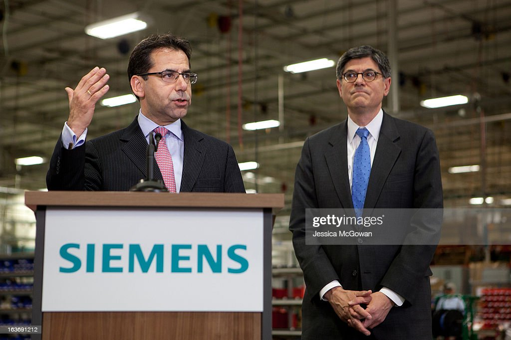 Siemens Industry Sector North America Helmuth Ludwig (L) speaks during a press conference about Treasury Secretary Jacob Lew's (R) visit to the Siemens manufacturing plant on March 14, 2013 in Alpharetta, Georgia. This Siemens facility manufactures drive components for major American industries. While in Atlanta, the Secretary will also meet with local business leaders to discuss the president's proposals to make America a magnet for new jobs and manufacturing, accelerate economic growth, and reduce our deficits.