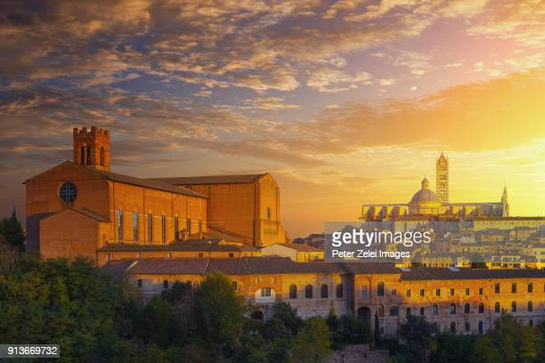 Siena cityscape with the Cathedral of Siena and Basilica San Domenico at sunset