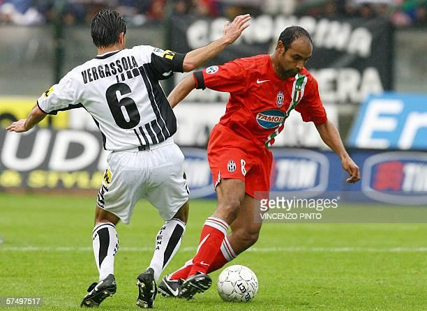 Juventus' Emerson Da Rosa vies with Simone Vergassola of Siena during their Italian Serie A soccer match at Artemio Franchi stadium in Siena 30 April...