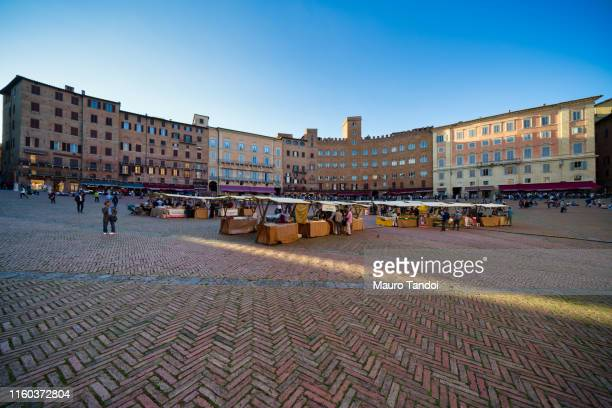 siena market at dusk, piazza del campo, tuscany - mauro tandoi stock photos and pictures