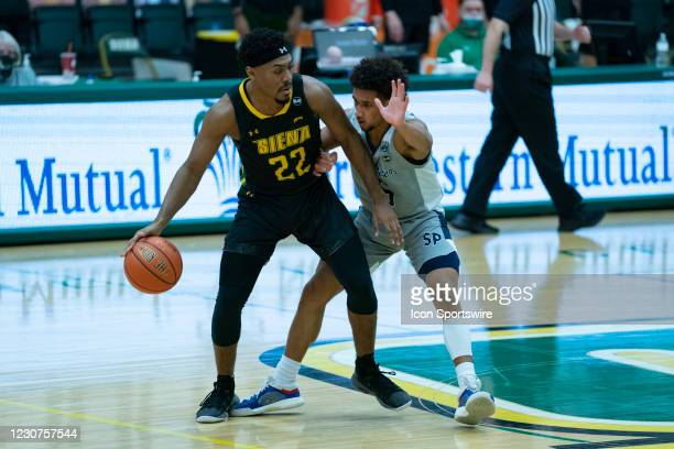 Siena Saints Guard Jalen Pickett dribbles the ball against Saint Peters Peacocks Guard Matthew Lee during the second half of the College Basketball...
