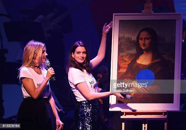Sienna Miller and Anne Hathaway perform during the Hillary Victory Fund Stronger Together concert at St James Theatre on October 17 2016 in New York...