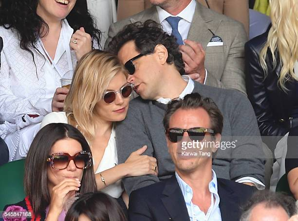 Sienna Miller and Bennett Miller attend the Men's Final of the Wimbledon Tennis Championships between Milos Raonic and Andy Murray at Wimbledon on...