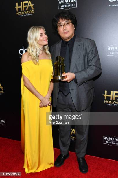 Sienna Miller and Bong Joon Ho winner of the Hollywood Filmmaker Award pose in the press room during the 23rd Annual Hollywood Film Awards at The...