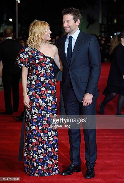 Sienna Miller and Bradley Cooper attend the UK Film Premiere of 'Burnt' at Vue West End on October 28, 2015 in London, England.
