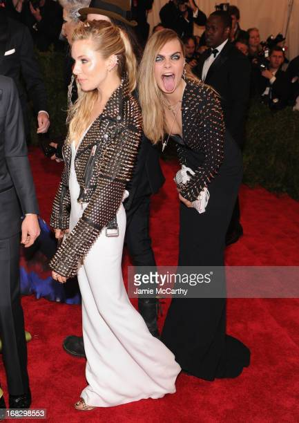 Sienna Miller and Cara Delevingne attend the Costume Institute Gala for the 'PUNK Chaos to Couture' exhibition at the Metropolitan Museum of Art on...