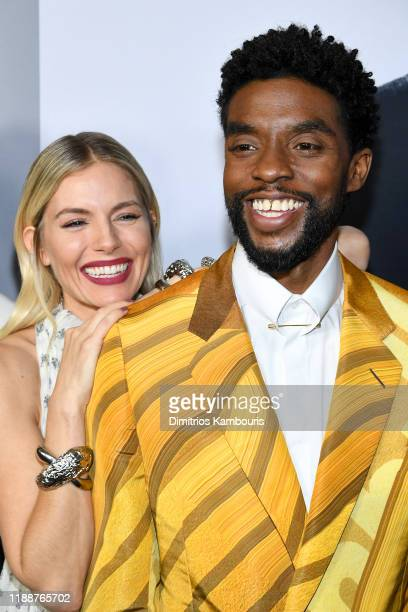 Sienna Miller and Chadwick Boseman attend the 21 Bridges New York Screening at AMC Lincoln Square Theater on November 19 2019 in New York City