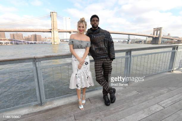 Sienna Miller and Chadwick Boseman pose during a photo call for 21 Bridges at The Fulton on November 19 2019 in New York City