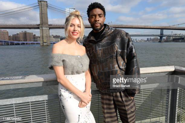 """Sienna Miller and Chadwick Boseman poses during a photo call for """"21 Bridges"""" at The Fulton on November 19, 2019 in New York City."""