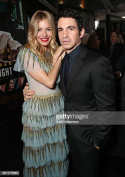 Sienna Miller and Chris Messina attend the premiere Of Warner Bros Pictures' 'Live By Night' at TCL Chinese Theatre on January 9 2017 in Hollywood...