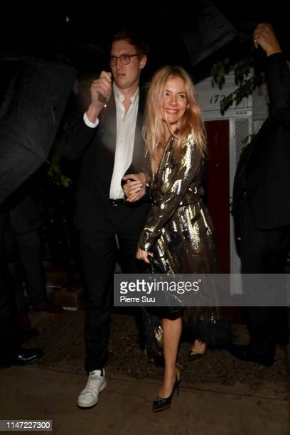Sienna Miller and her boyfriend Lucas Zwirner leave a Pre Met Gala dinner party on May 05, 2019 in New York City.