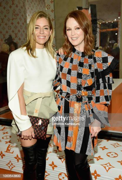 Sienna Miller and Julianne Moore attend the Louis Vuitton X Grace Coddington Event on October 25 2018 in New York City