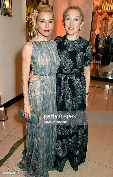 Sienna Miller and Justine Picardie attend the Harper's Bazaar Women of the Year Awards 2015 at Claridges Hotel on November 3 2015 in London England