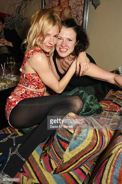 Sienna Miller and Katie Grand attend the LOVE Christmas party at George on December 18 2015 in London England