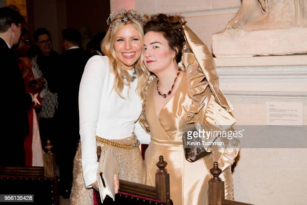 Sienna Miller and Lena Dunham attend the Heavenly Bodies: Fashion & The Catholic Imagination Costume Institute Gala at The Metropolitan Museum of Art...
