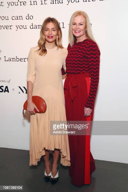 Sienna Miller and Mary Ann Reilly attend the Visa x IMG Fashion Holiday Dinner at The Glasshouses on November 13, 2018 in New York City.