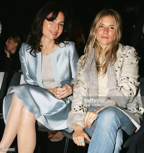 Sienna Miller and Minnie Driver attend the Amanda Wakeley fashion show as part of London Fashion Week Autumn/Winter 2005/6 at the BFC Tent Battersea...