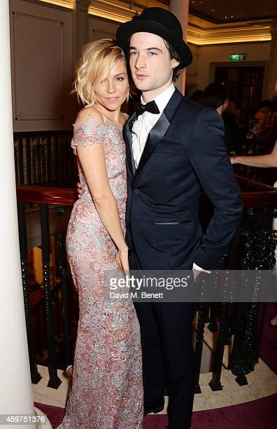 Sienna Miller and Tom Sturridge attend a champagne reception at the 60th London Evening Standard Theatre Awards at the London Palladium on November...