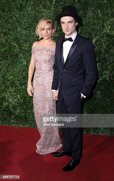 Sienna Miller and Tom Sturridge attend the 60th London Evening Standard Theatre Awards at London Palladium on November 30 2014 in London England