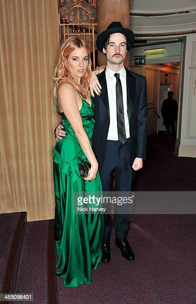 Sienna Miller and Tom Sturridge attend the British Fashion Awards 2013 at London Coliseum on December 2 2013 in London England