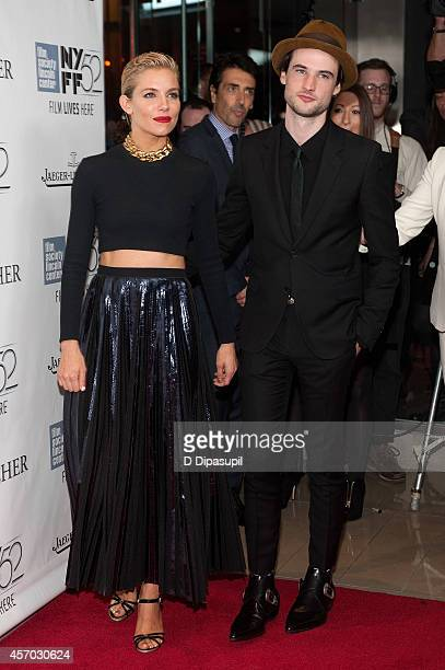 Sienna Miller and Tom Sturridge attend the 'Foxcatcher' premiere during the 52nd New York Film Festival at Alice Tully Hall on October 10 2014 in New...