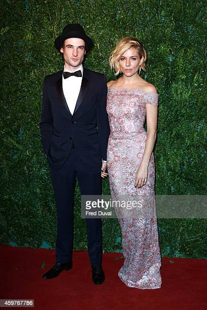 Sienna Miller and Tom Sturridge attends the 60th London Evening Standard Theatre Awards at London Palladium on November 30 2014 in London England
