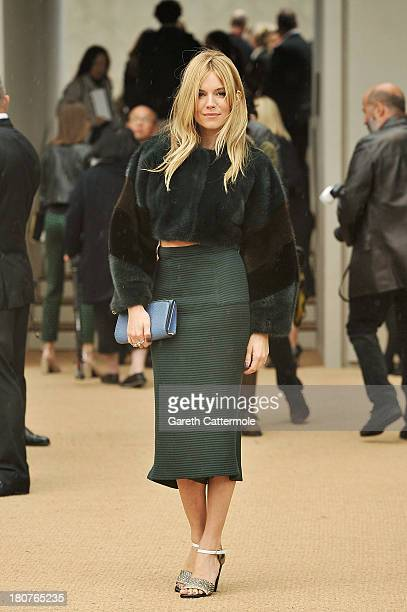 Sienna Miller arrives at Burberry Prorsum Womenswear Spring/Summer 2014 show during London Fashion Week at Kensington Gardens on September 16 2013 in...