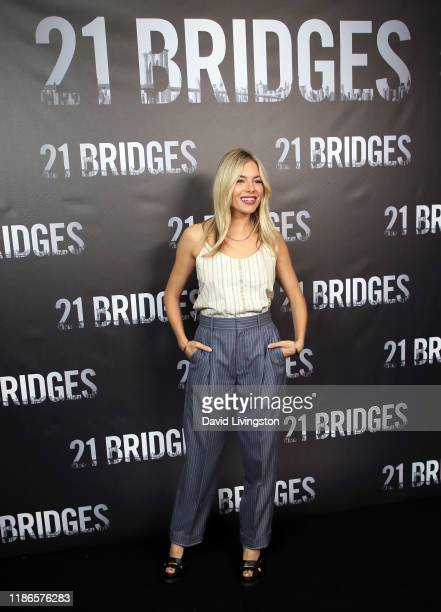"""Sienna Miller attends a photocall for STX Entertainment's """"21 Bridges"""" at Four Seasons Hotel Los Angeles at Beverly Hills on November 09, 2019 in Los..."""