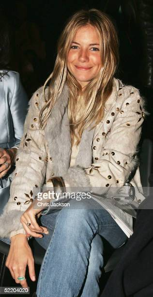Sienna Miller attends the Amanda Wakeley fashion show as part of London Fashion Week Autumn/Winter 2005/6 at the BFC Tent Battersea Park on February...