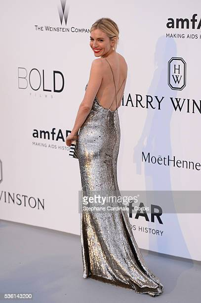 Sienna Miller attends the AmfAR Red Carpet during the 68th Cannes Film Festival on May 21 2015 in Cannes France