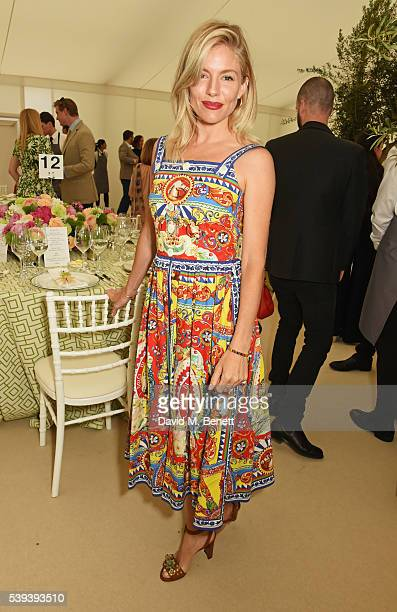 Sienna Miller attends The Cartier Queen's Cup Final at Guards Polo Club on June 11 2016 in Egham England