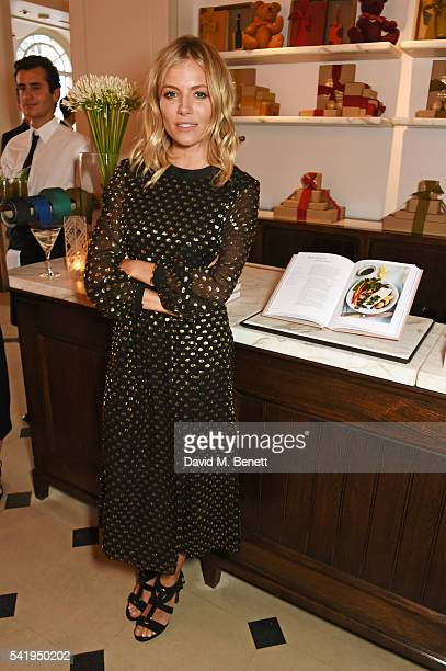 Sienna Miller attends the launch of Wendy Rowe's new book 'Eat Beautiful' hosted by Sienna Miller at Burberry's all day cafe Thomas's on June 21 2016...